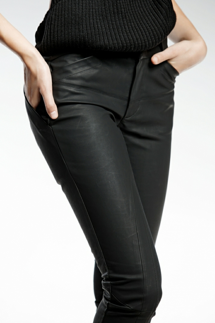Unisex slim fit pants made with two fabrics, with decorative cuts and loops