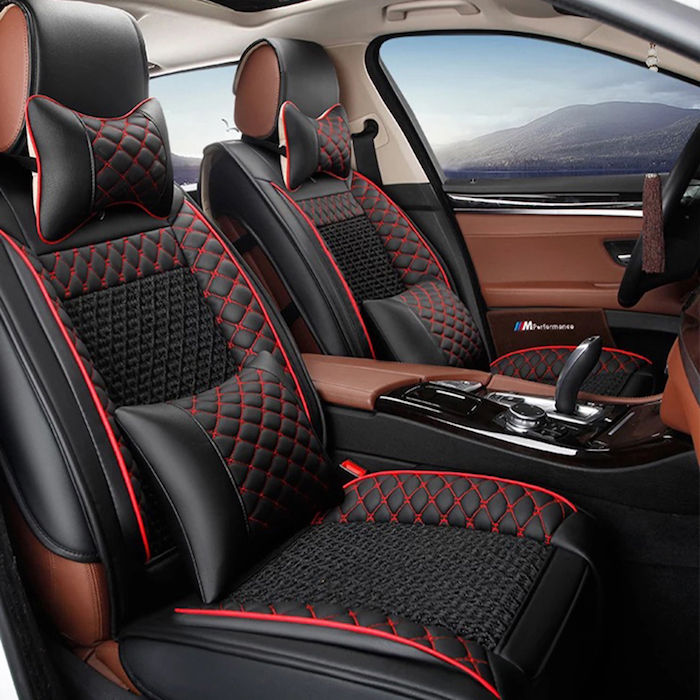 fancy car with leather seats in black and red, seat pillow