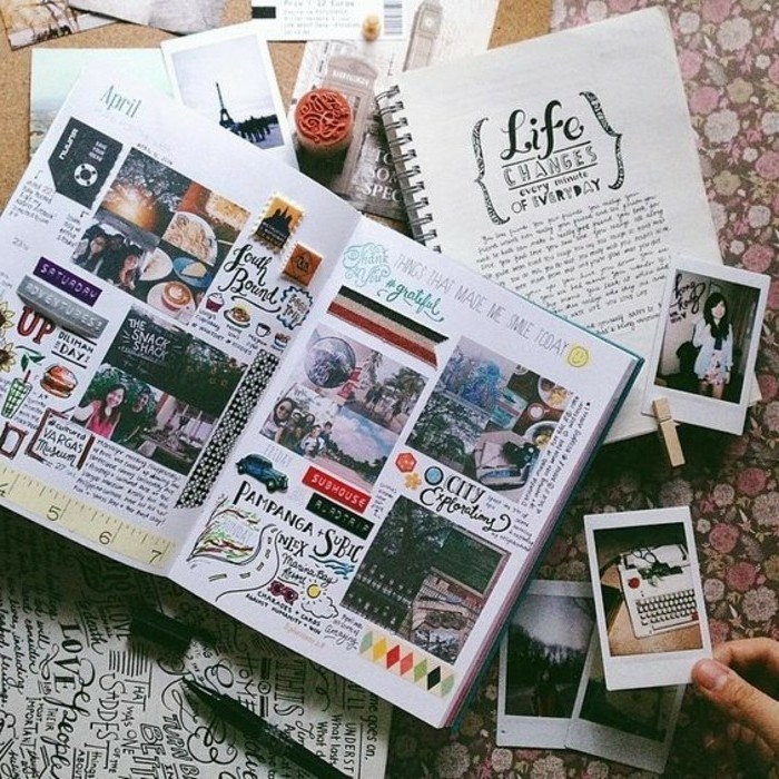 adventure journal ideas, many scrapbooks and materials on a flowery background, hand holding photo, more photos and cutouts in the background