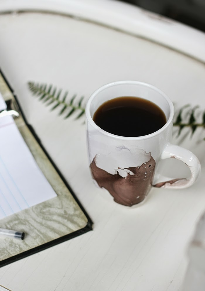 diy gift ideas, beautiful decorated mug full of coffee, placed on white table near an open note book
