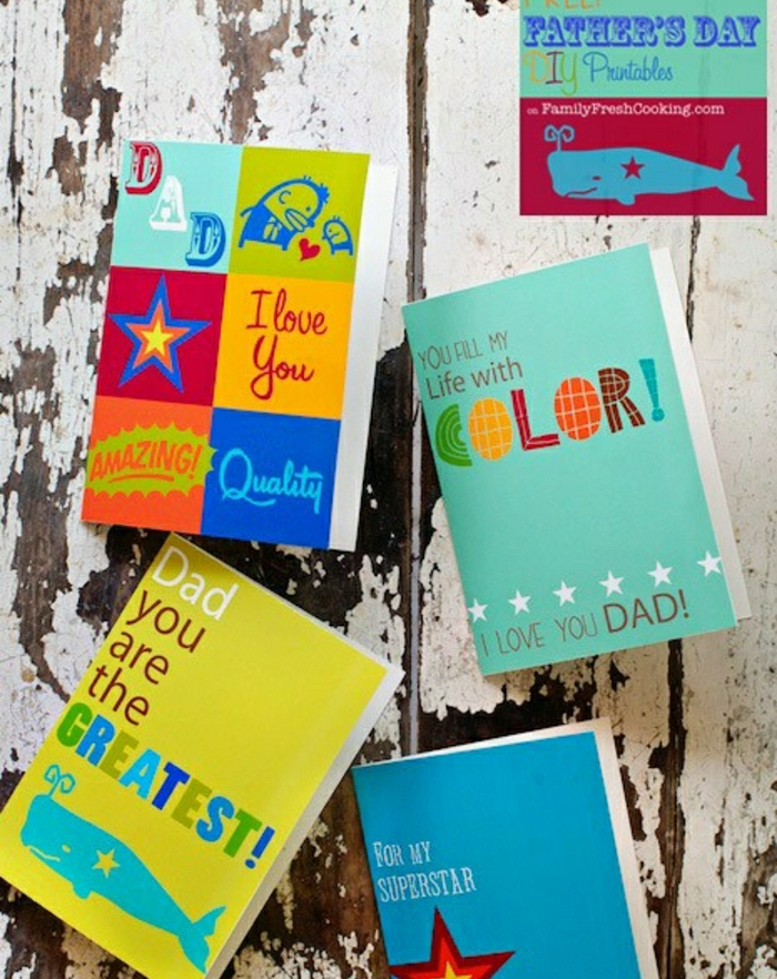 customized father's day cards in various colors, on an old, wooden table