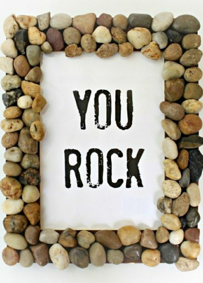 "frame made from small pebbles glued together, with the message ""you rock"" in the middle"