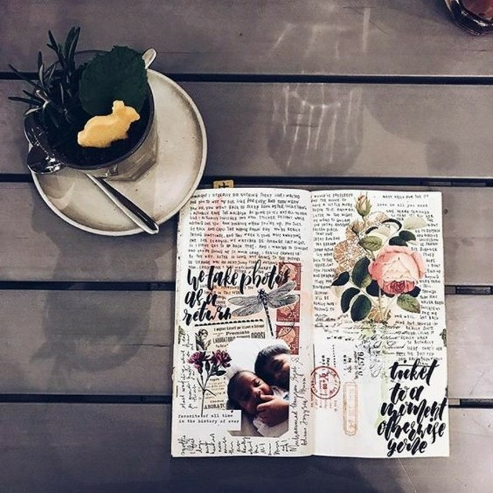 scrapbooking ideas, diary, white pages, cutouts of flowers, rose, children, stamps,writing, on a table, near a glass with desert