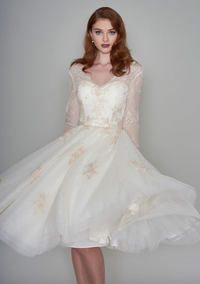 tea length wedding dresses, auburn-haired young bride with knee-length white dress, with cream embroidery and sheer sleeves