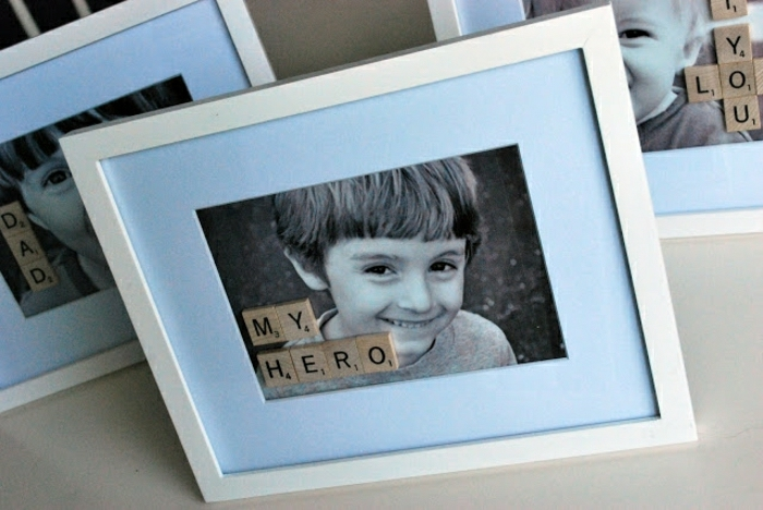 "step dad gift ideas, a black and white photo of a young boy, in a white frame, with the words ""my hero"" written with scrabble letters"