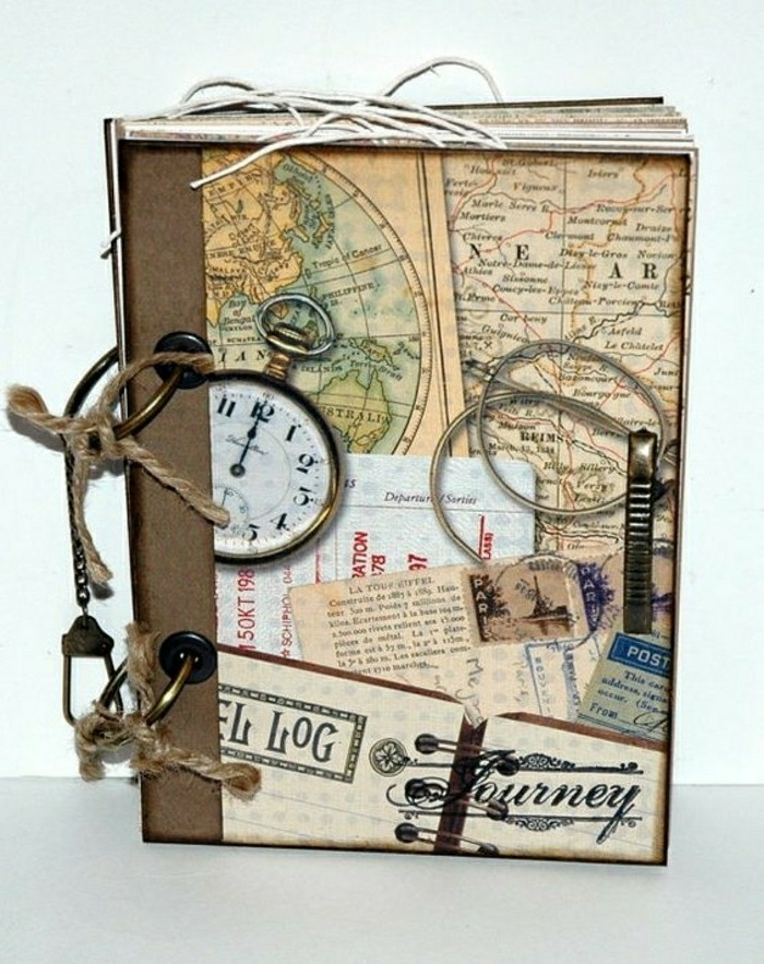 travel journal, brown, yellow, orange cover, vintage cutouts, watch, stamps, travel tickets, string, cord, key chain, white background