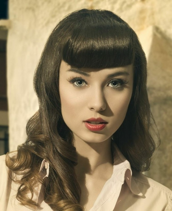 betty bangs, pale woman with heavy make up and dark retro-styled shoulder-length hair, red lipstick fake lashes light shirt