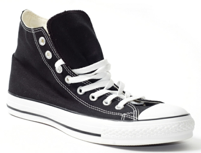 black converse-type sneaker close up, white laces and white rubber soles, plain white background