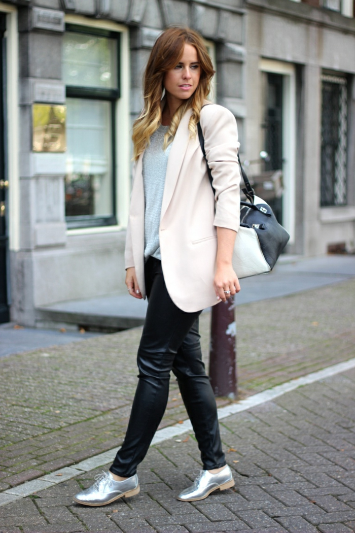 business casual attire for women, black shiny skinny trousers, pale pink blazer and grey top, shiny silver shoes, black and white shoulder bag