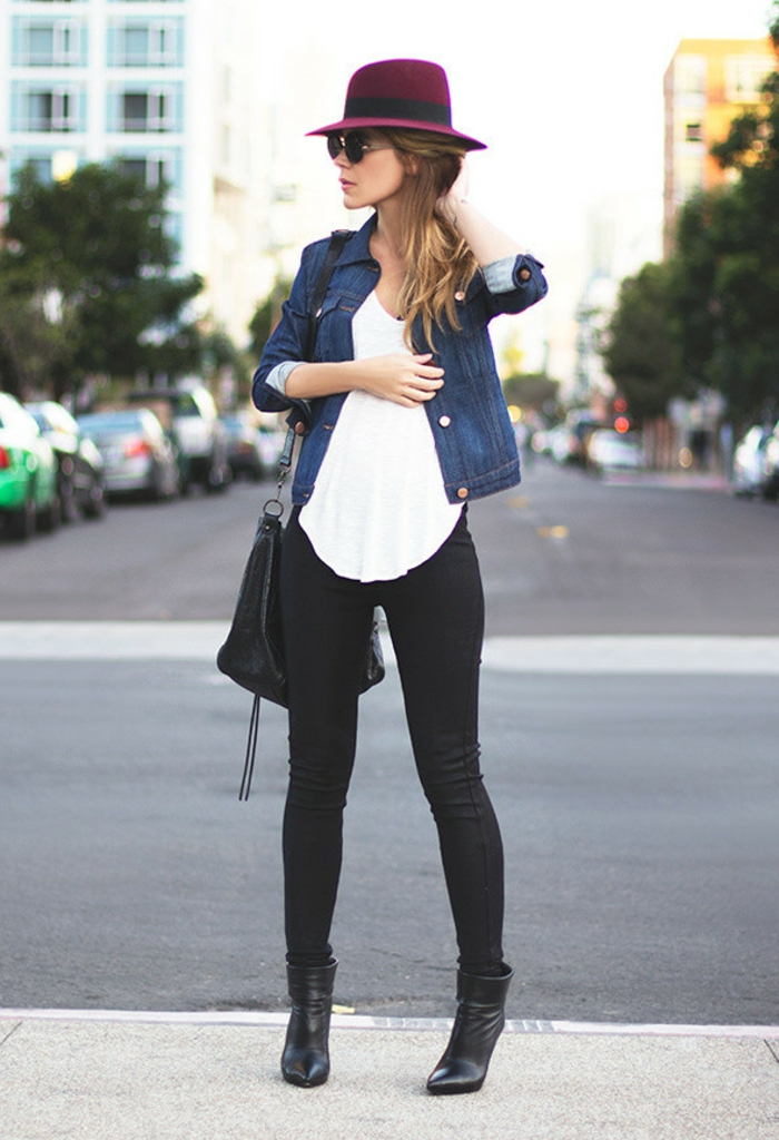 business attire for women, black skinny trousers and ankle boots, white top and dark denim jacket, black bag and purple felt hat, on blonde woman with sunglasses