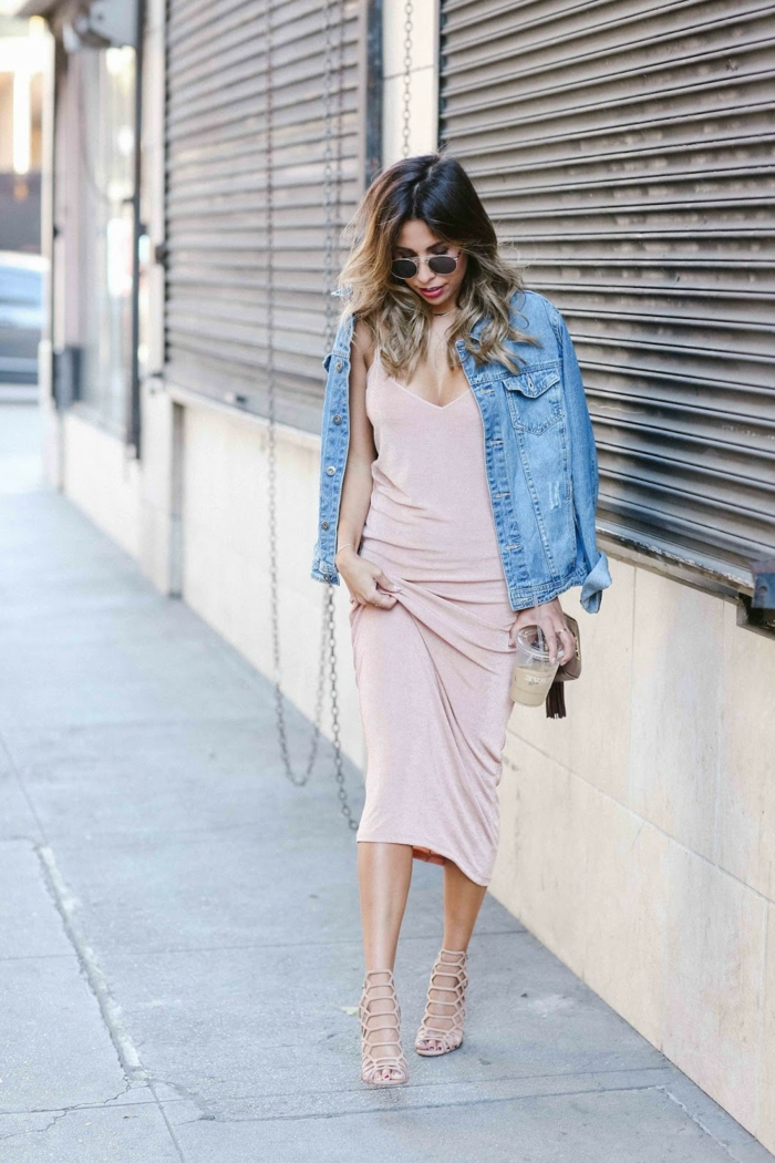 business attire for women, woman with brown and blond ombre hair, long pale pink dress and denim jacket