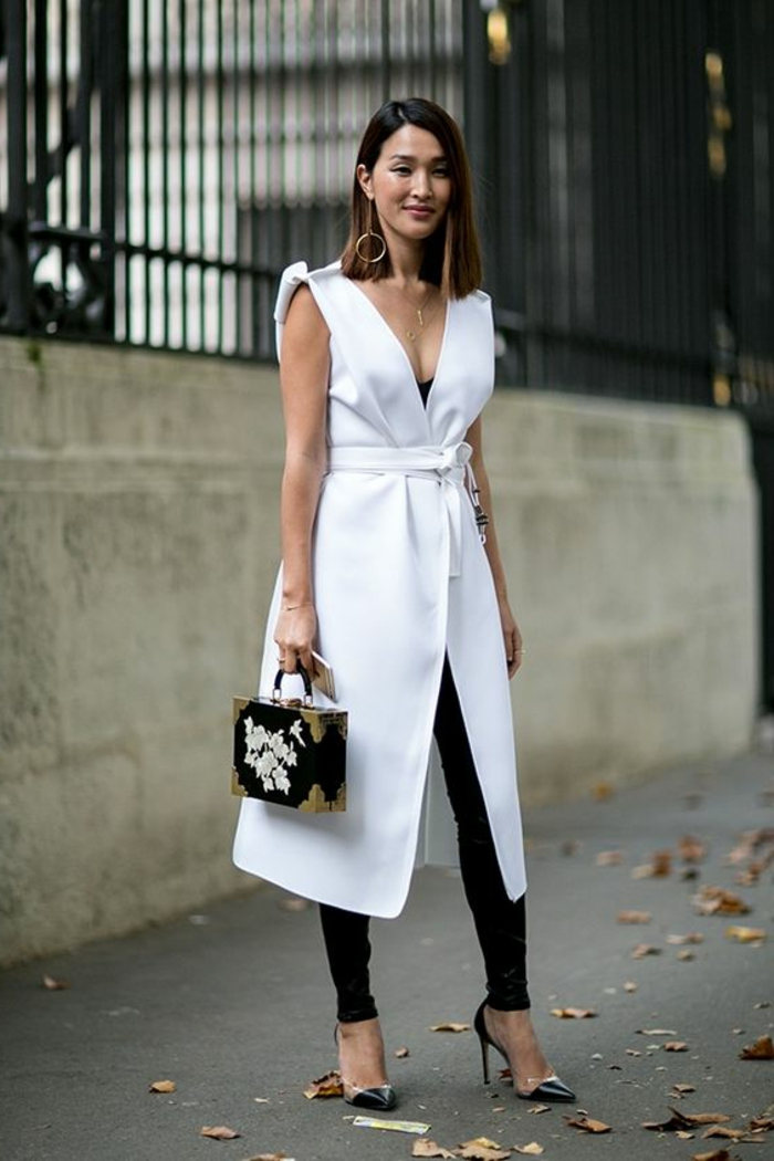 business casual dresses, white wrap-over dress, black leggings and dark blue stilettos, small rectangular bag and phone, delicate necklace and earring, worn by asian woman with brown hair