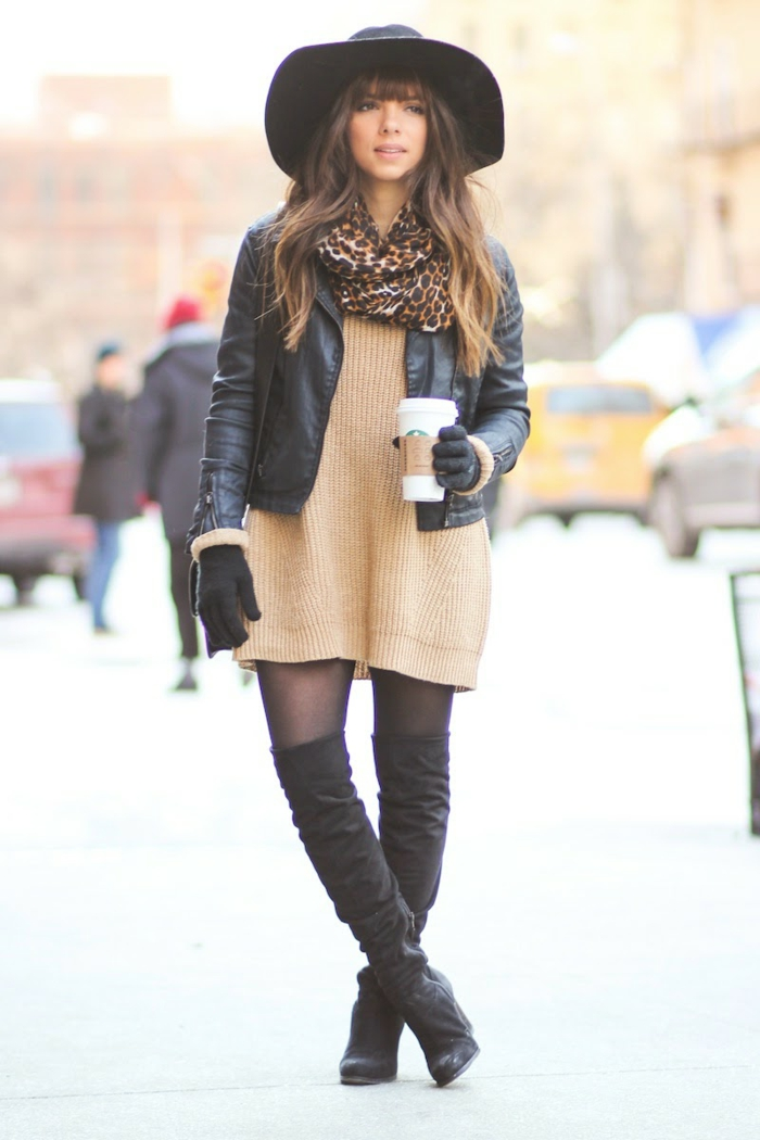 business attire for women, brunette woman with brown wavy hair, pale brown sweater dress, over-the-knee boots and big black hat