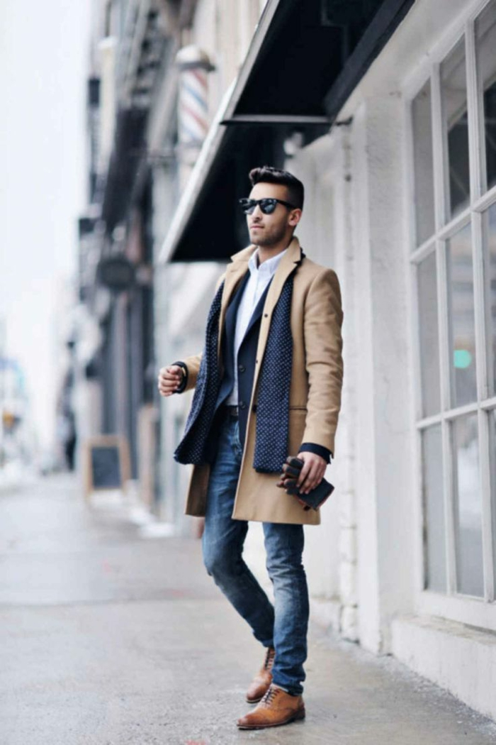 business casual outfits, brown leather shoes, jeans with white shirt and dark navy blazer, camel brown coat and navy scarf, worn by man with sunglasses, holding leather gloves