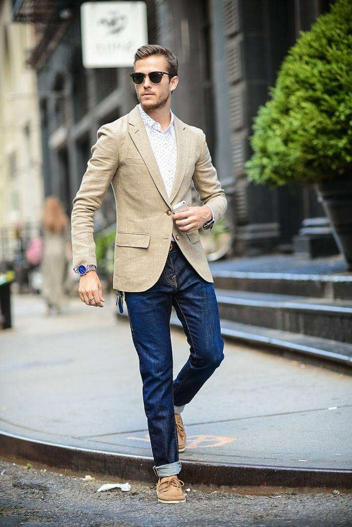 business professional attire, man with sunglasses and light shirt, pale camel brown blazer, dark denim jeans and brown loafers