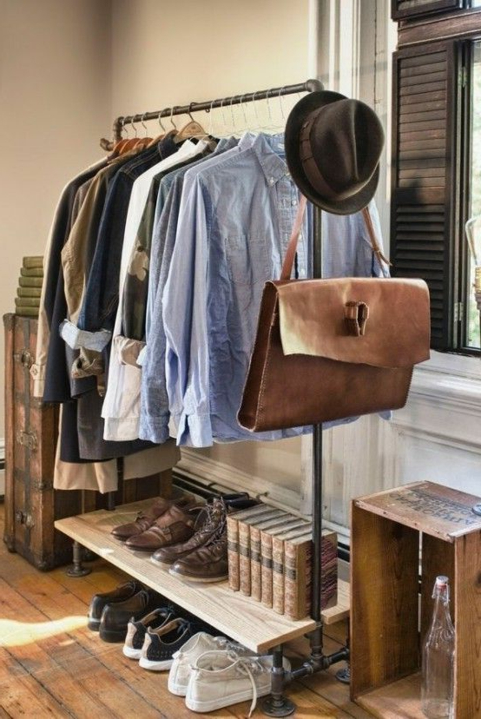 business professional attire, metal clothes rack, pale blue shirts, various tops and blazers, several pairs of shoes, books a bag and a hat