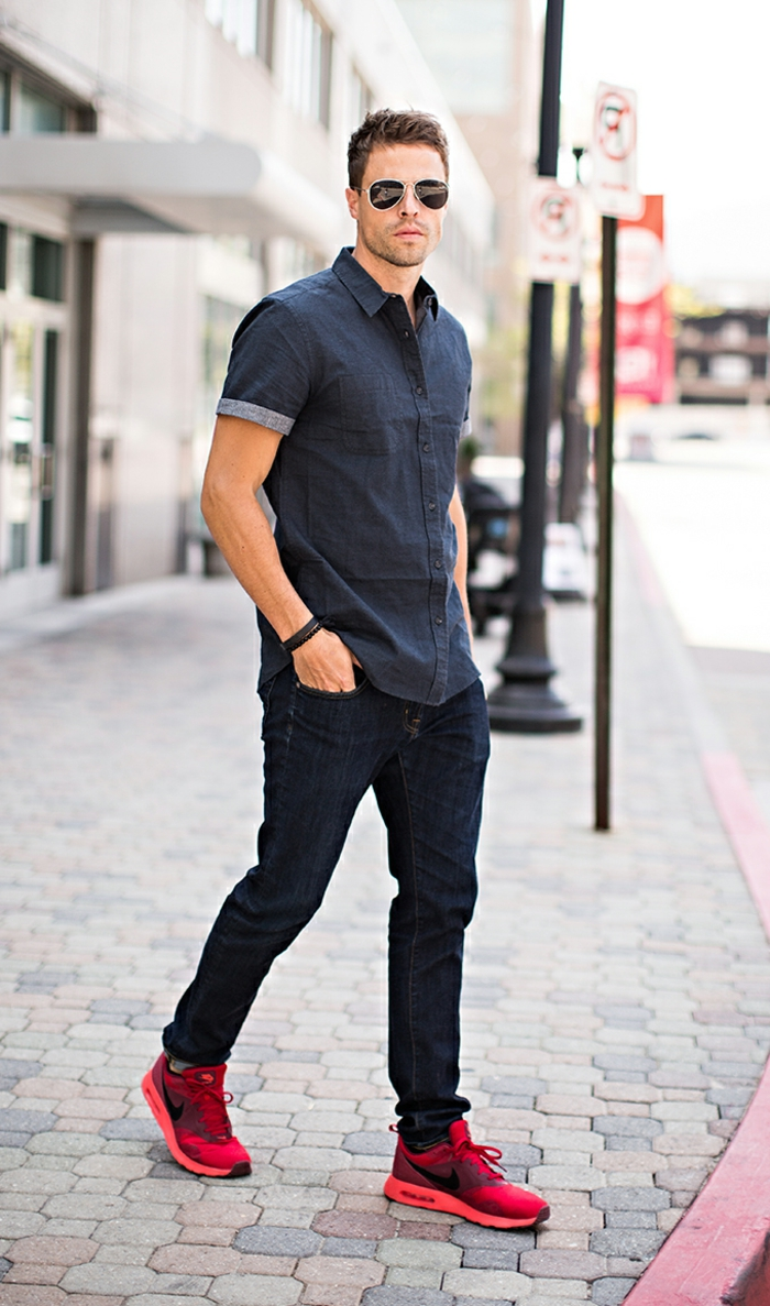 business casual outfits, man with sunglasses, wearing dark denim shirt with short sleeves, dark jeans and bright red sneakers