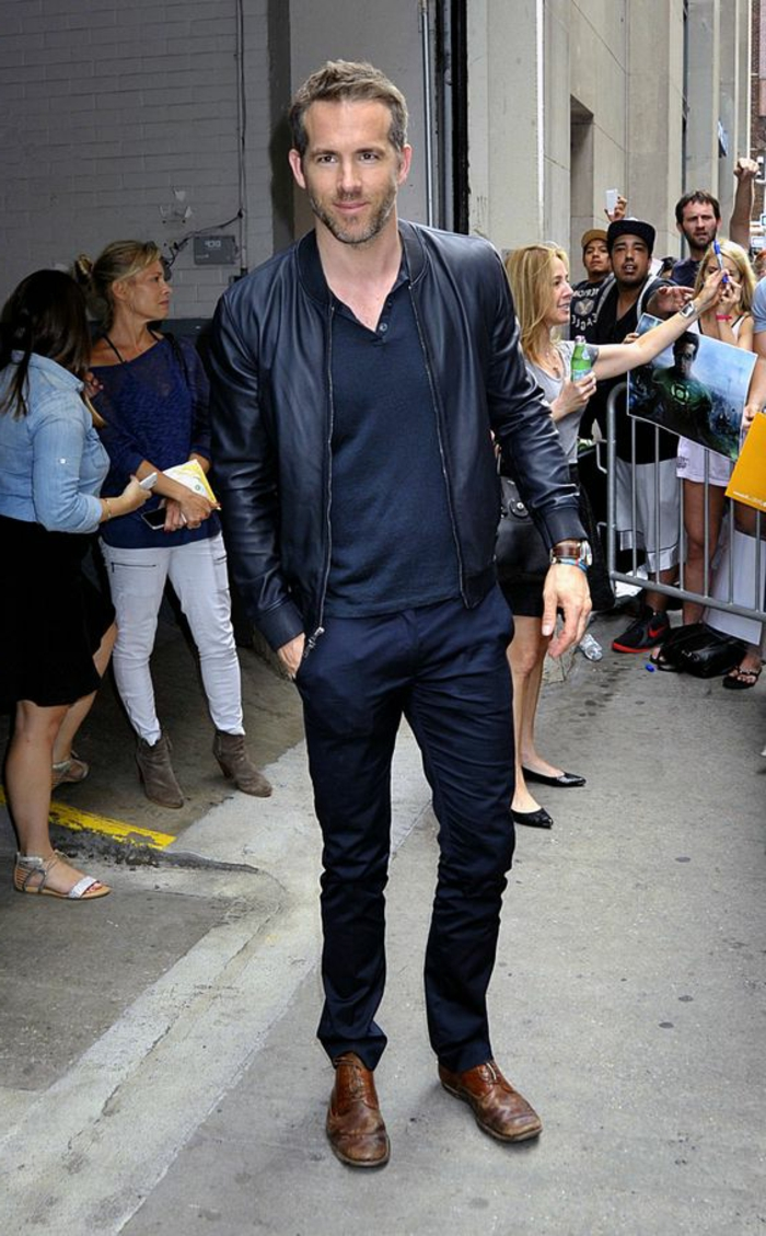 business professional attire, ryan reynolds wearing dark navy pants, black top and black leather jacket, with brown leather shoes