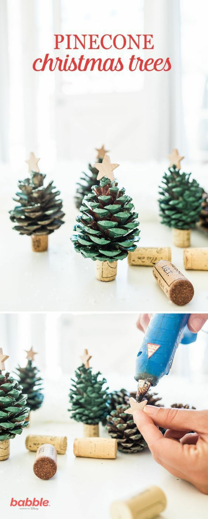 several little christmas trees, made from pine cones painted green and cork wine stoppers, with little golden stars stuck on top, hand putting glue on star with glue gun