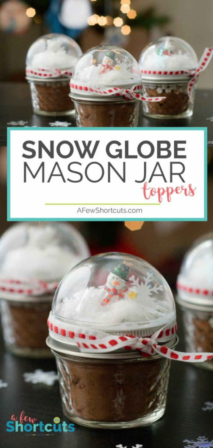diy christmas gifts, small mason jars filled with cocoa powder, with snow globe toppers, containing fake snow figurines and confetti, red and white ribbons