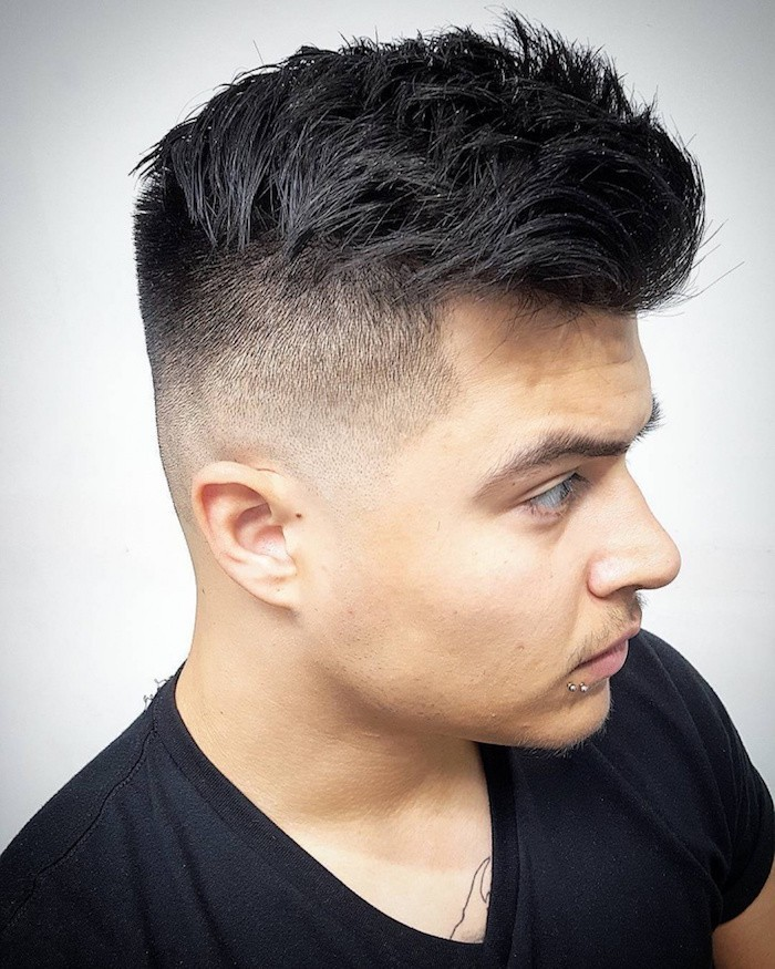 how to style a undercut, young man with dark hair, kept longer on top, shaven on the side, wearing black t-shirt, with two piercings on his lip and a chest tattoo