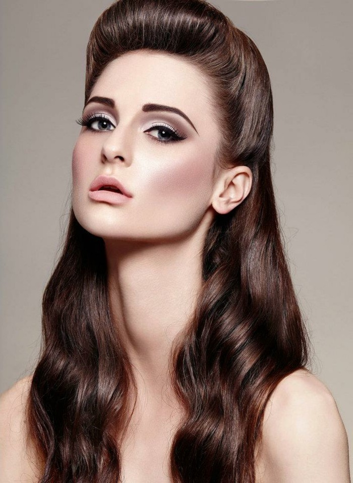 vintage hairstyles, young brunette woman with long dark brown hair, nude lipstick blush and heavy eye makeup, long neck and nude shoulders