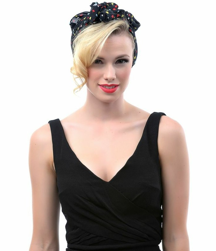 pin up girl hairstyles, girl with long blonde bangs curled at the end, wearing black bandanna with red and yellow heart print, black tank top, bright red lipstick and eye makeup