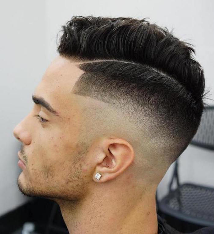 how to style a undercut, young man with dark hair, side parting and short on the side, long wavy and gelled up on top, square diamante earring, stubble on chin and upper lip