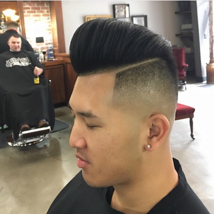 slicked back undercut, Asian man with closed eyes facing sideways, very short side hair and long top hair in pompadour style, brushed back with gel