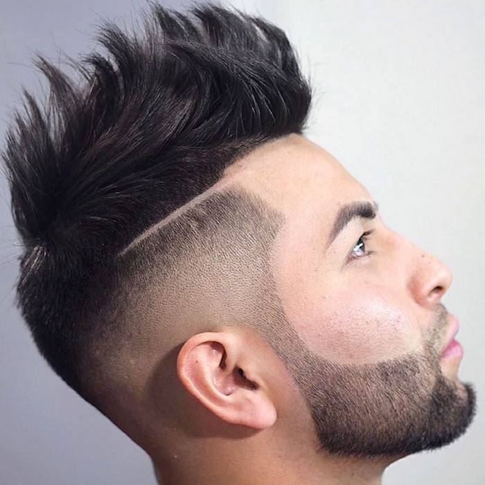 undercut hairstyle men, close up of asian man facing up and sideways, black beard mustache and side hair trimmed short, top hair kept long and gelled up