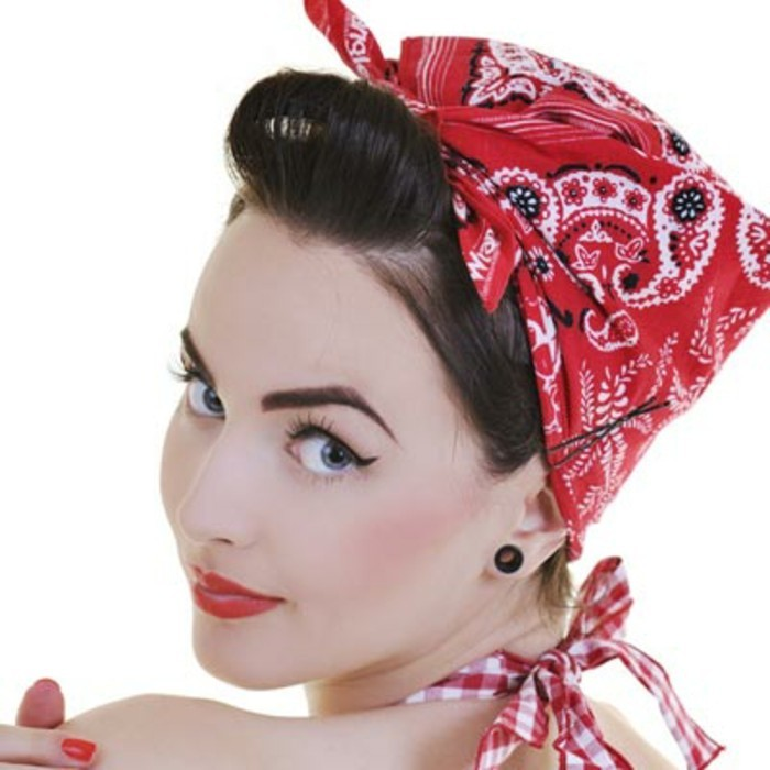 woman looking backwards over shoulder, retro hairstyle with curled bangs, red bandanna with white and black details, wearing black earring, eyeliner fake lashes and lipstick