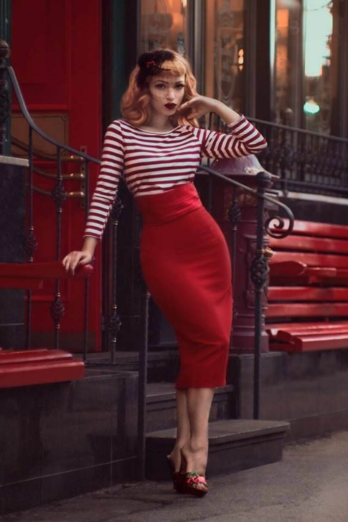 betty bangs, copper red-haired woman with hair ornament and retro curls, red and white striped top and red pencil skirt, high-heeled shoes