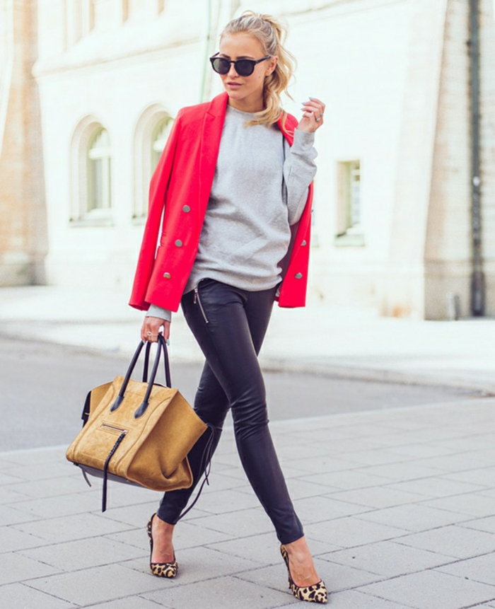 business casual attire for women, blonde woman with ponytail, wearing grey top and black leather trousers, hot pink blazer over shoulders, with high heels and camel brown leather bag