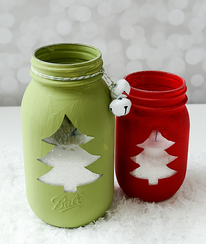 xmas gifts, two lanterns made from a big green jar and a smaller red jar, with Christmas tree-shaped windows, full of sugar and placed on fake snow, green and white thread with two white bells