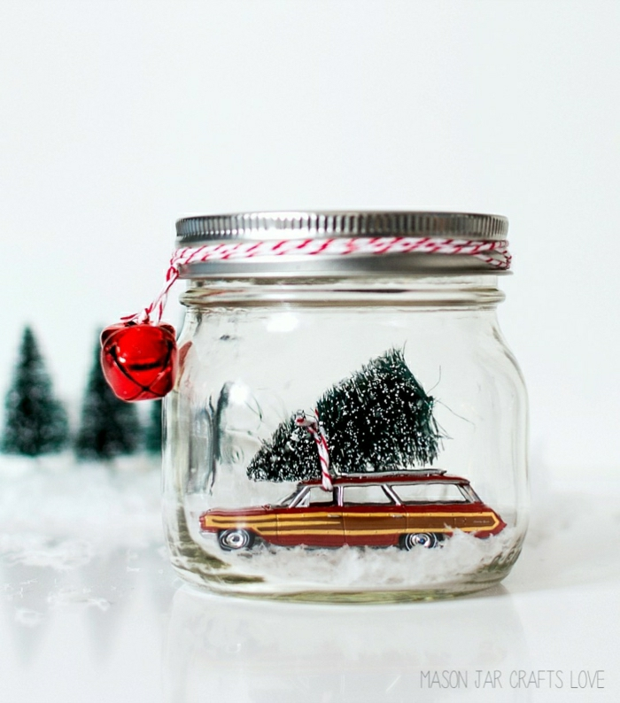 homemade christmas gift ideas, reddish -brown retro car miniature, inside a clear bell jar with screw cap, small tree figurine tied to car with red and white string, red bells tied to jar lid