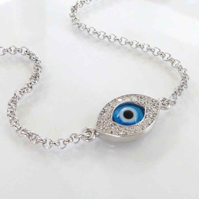 baby eye color, bracelet with silver chain, featuring charm with blue stone looking like an eye