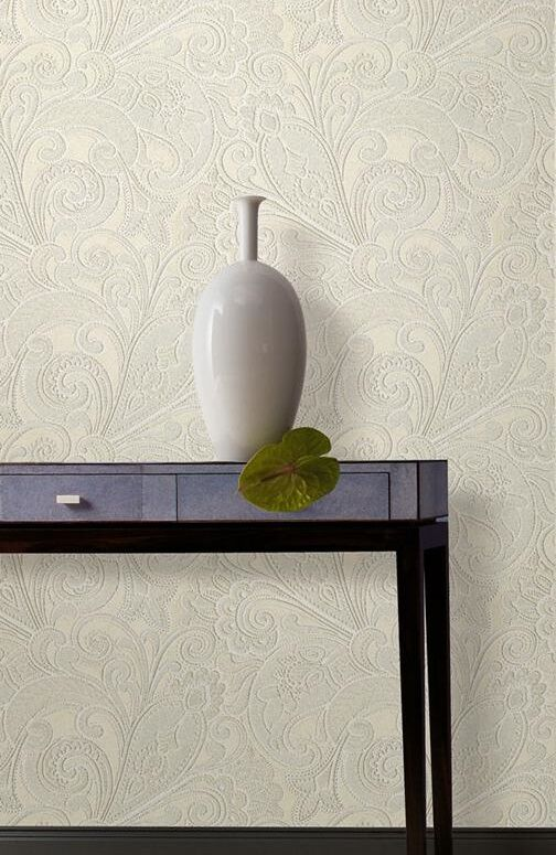 rococo-style wallpaper in cream, abstract floral pattern, minimalist brown wooden table and white vase