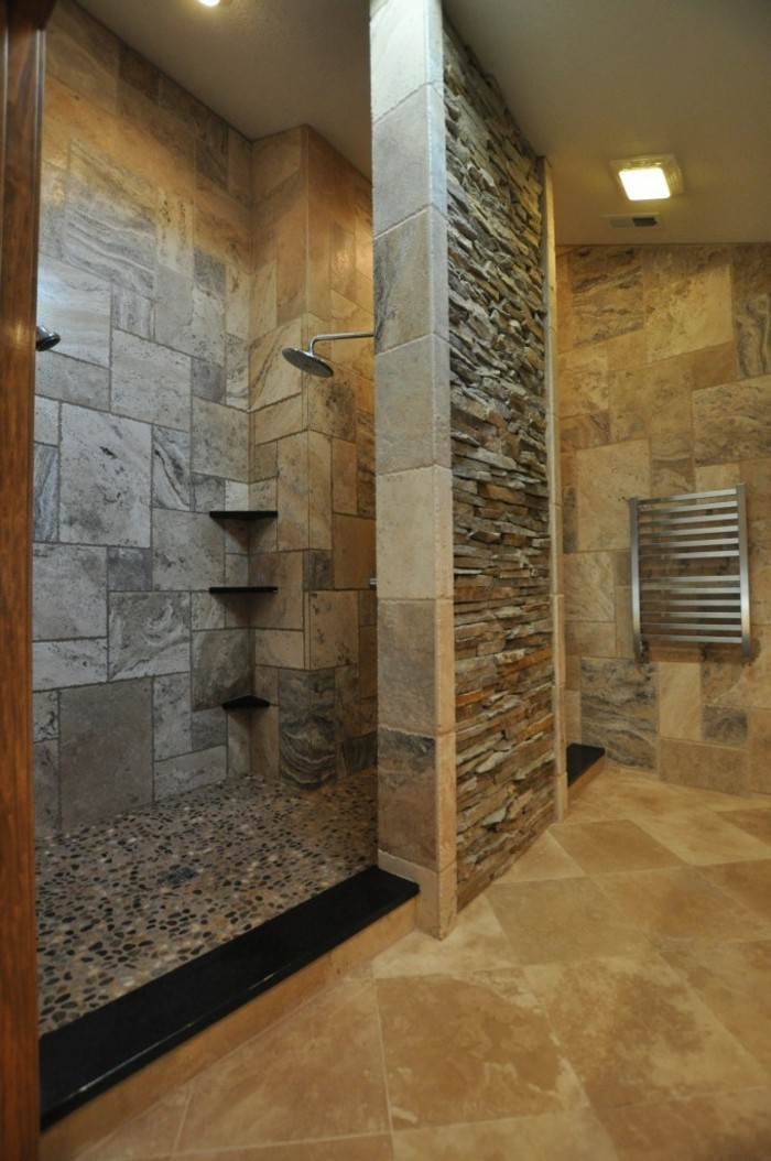 bathroom remodel, grayish-brown stone tiles, pebble flooring in shower area, orange floor tiles, natural stone inserts