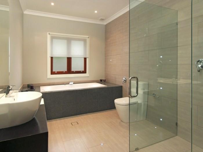 bathroom remodel, rectangular inbuilt bath, light wood flooring, white sink and toilet, glass shower cabin