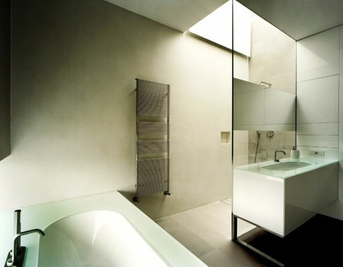 bathroom makeovers, bathroom with cream walls, white ceramic tub with glass top, white rectangular sink, shower behind glass wall