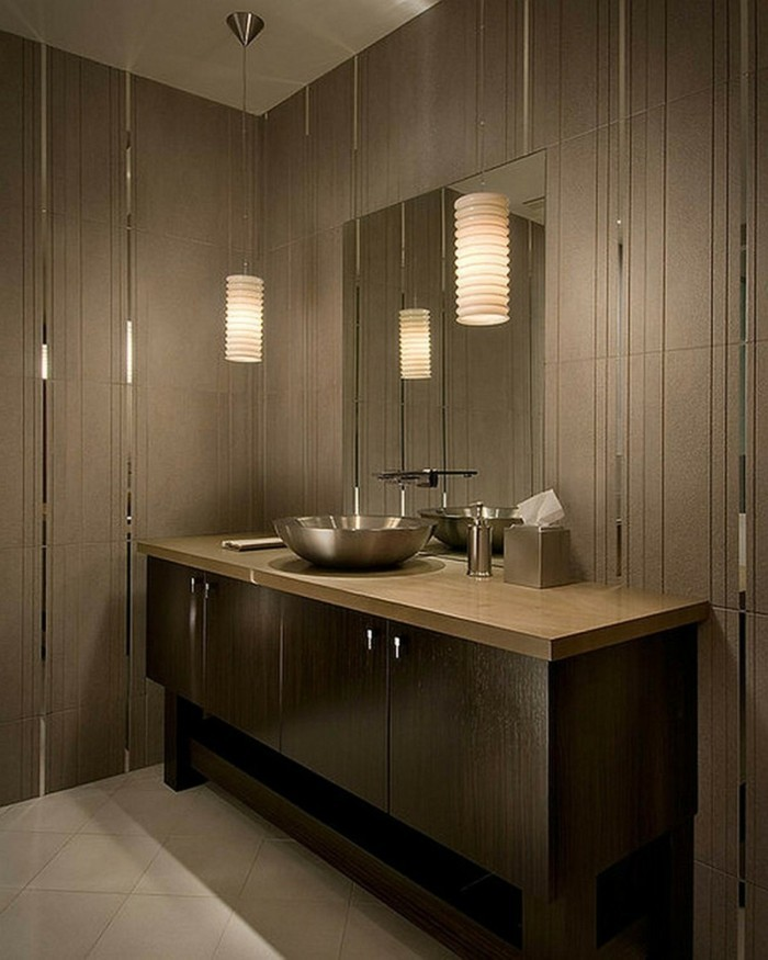 bathroom renovations, room with brown walls with mirror details, large brown cupboard with round metal sink, wall mirror and two hanging lights