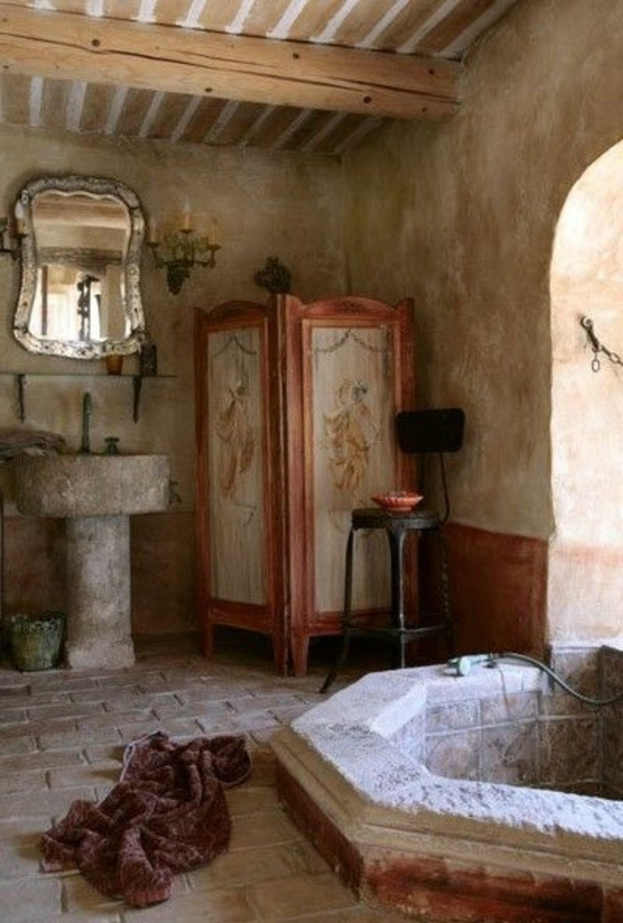 bathroom ideas photo gallery, rustic vintage bathroom, stone sink and ornate mirror, inbuilt stone bath, stone tile flooring