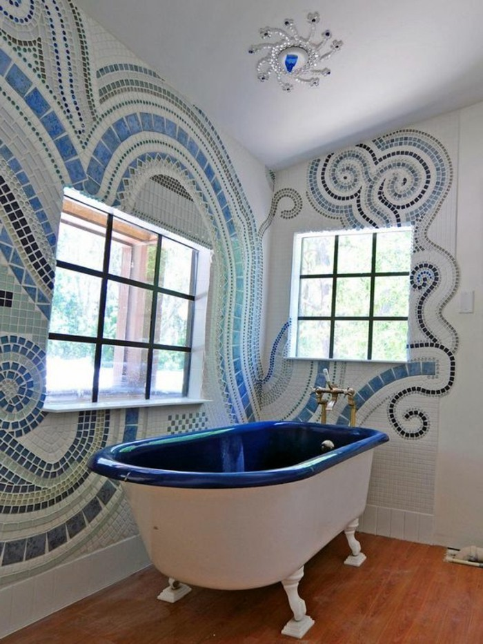 bathroom designs, room with wooden floor, mural made from tiny blue stones in different shades on walls, white and dark blue tub