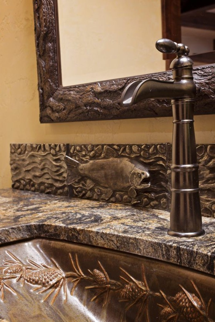 bathroom design ideas, close up of ornate metal sink with fish detail and marble top, vintage looking tap, mirror with old metal frame