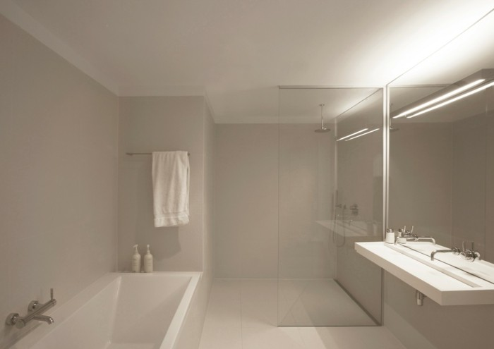 remodeling ideas, white ceiling and light cream walls and floor tiles, white bath and large sink with two water taps, big wall mirror and glass divide