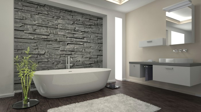 bathroom remodel ideas, solid wooden floor, cream and white walls, one wall has natural stone insert, white bath near sink and mirror