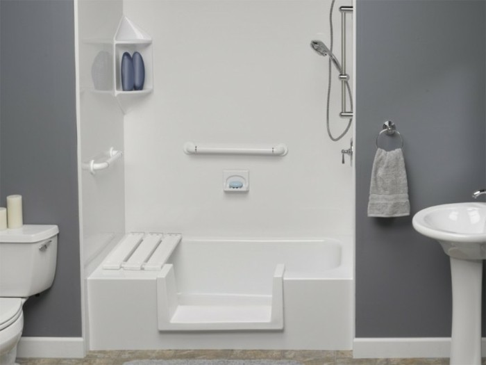 bathroom remodel, dark grey walls, inbuilt sit-down shower area in white, ceramic toilet and sink