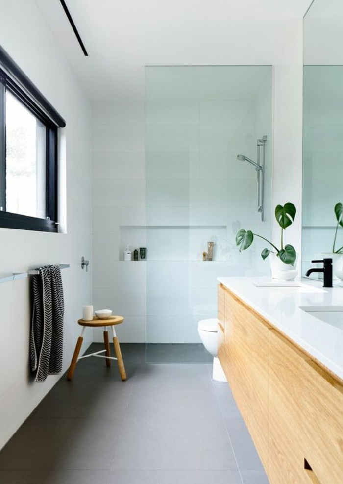 bathroom designs, grey floor tiles, white sink over large wooden cupboard, shower area with partial glass divide