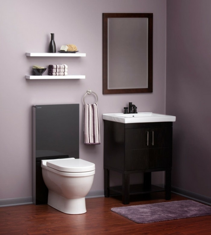 bathroom ideas photo gallery, pale purple walls, dark wooden floor, fluffy purple rug, black and white toilet, black cupboard with white sink