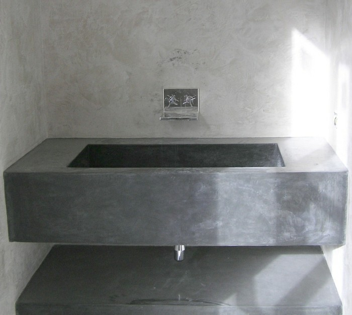 bathroom makeovers, massive grey concrete sink, metal taps on light grey-wash wall
